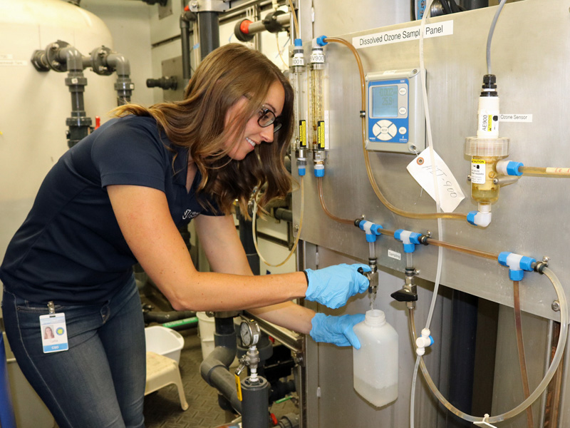 Lydia Peri, the Emerging Resources Program Administrator for the Truckee Meadows Water Authority, takes a sample for the OneWater Nevada Initiative.